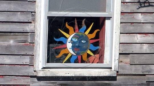 Sunface in shack window